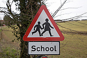 Red triangular school road sign