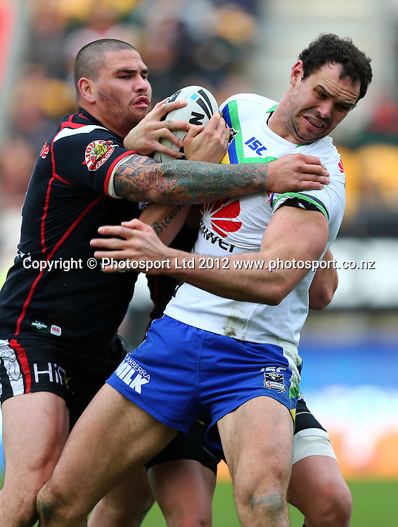 Dane Tilse of the Raiders looks to beat the tackle of Russell Packer of the Warriors during the NRL game, Vodafone Warriors v Canberra Raiders, Mt Smart Stadium, Auckland, Sunday 2 September  2012. Photo: Simon Watts /photosport.co.nz