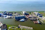 Nederland, Friesland, Harlingen, 07-05-2018; Industriehaven met onder andere Damen Shiprepair, Reststoffen Energie Centrale (REC), ICON Yachts.<br /> Harlingen industrial harbour<br /> <br /> luchtfoto (toeslag op standaard tarieven);<br /> aerial photo (additional fee required);<br /> copyright foto/photo Siebe Swart