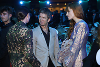 Nadine Shah, Noel Gallagher, Florence + The Machine talking shortly before the show began