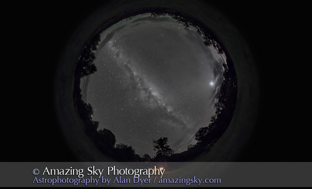 A 360&deg; x 220&deg; fish-eye panorama of the southern night sky, showing the Milky Way all the way across the sky with the centre of the Galaxy directly overhead. The Dark Emu extends from the Coal Sack at upper left to the dark lanes in Scutum at lower right. Venus is rising at right amid the zodical light and some cloud. Mars, at opposition, is just setting behind the trees at left. <br /> <br /> I shot this at 4:30 a.m. April 11, 2014 from the Two Styx Cabins just outside the boundary of New England National Park, NSW, Australia. This is a stitched panorama composed of 6 segments, each taken with an 8mm fish-eye lens on the Canon 5D Mark II. So while one image with this lens aimed straight up would have recorded a similar scene. taking a panorama of 6 images, at 60&deg; spacings, and stitching them allows the image to extend below the horizon to take in more of the ground, creating a scene that takes in a full 360&deg; in azimuth but more than 180&deg; in altitude.<br /> <br /> Each segment is a 1-minute untracked exposure at f/3.5 and ISO 4000. So the stars are slightly trailed. The images were stitched in PTGui using the spherical projection mode. Finishing was in Photoshop. This version of the image has been processed to make the view better resemble what you see with the unaided eye, in a largely monochrome and softer view than the colourful and high-contrast views commonly presented in astrophotos. Even at that there is more fine structure present in the Milky Way than the unaided eye usually sees, though binoculars beging to reveal that smaller detail. I have left some colours in some stars and in the foreground of landscape scenes.