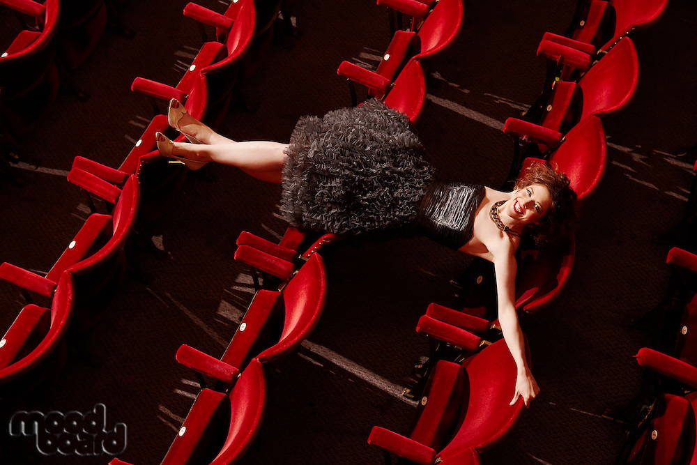 Woman lying on theatre stalls high angle view