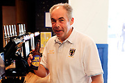 AFC Wimbledon fan enjoying a AFC Wimbledon beer during the Pre-Season Friendly match between AFC Wimbledon and Burton Albion at the Cherry Red Records Stadium, Kingston, England on 21 July 2017. Photo by Matthew Redman.
