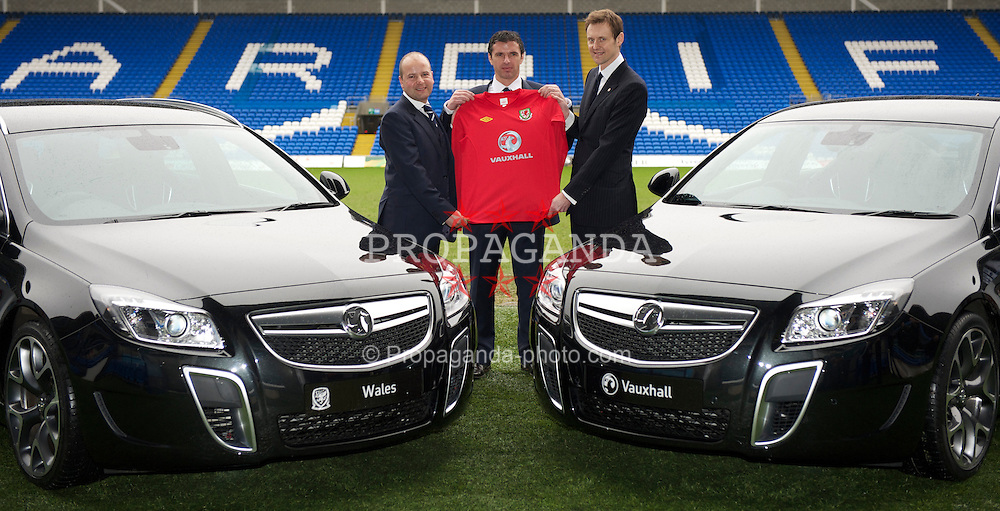 CARDIFF, WALES - Wednesday, January 12, 2011: Wales' manager Gary Speed (C) with Chief-Executive Jonathan Ford (L) and Vauxhall Managing Director Duncan Aldred photographed next to Vauxhall cars during the announcement that British car manufacturer Vauxhall is to become the official leading sponsorship partner to the Wales international football teams, at Cardiff City Stadium. (Pic by: David Rawcliffe/Propaganda).+++ THIS IMAGE IS FREE TO USE IN CONJUNCTION WITH EDITORIAL OF VAUXHALL'S SPONSORSHIP OF THE FAW. +++