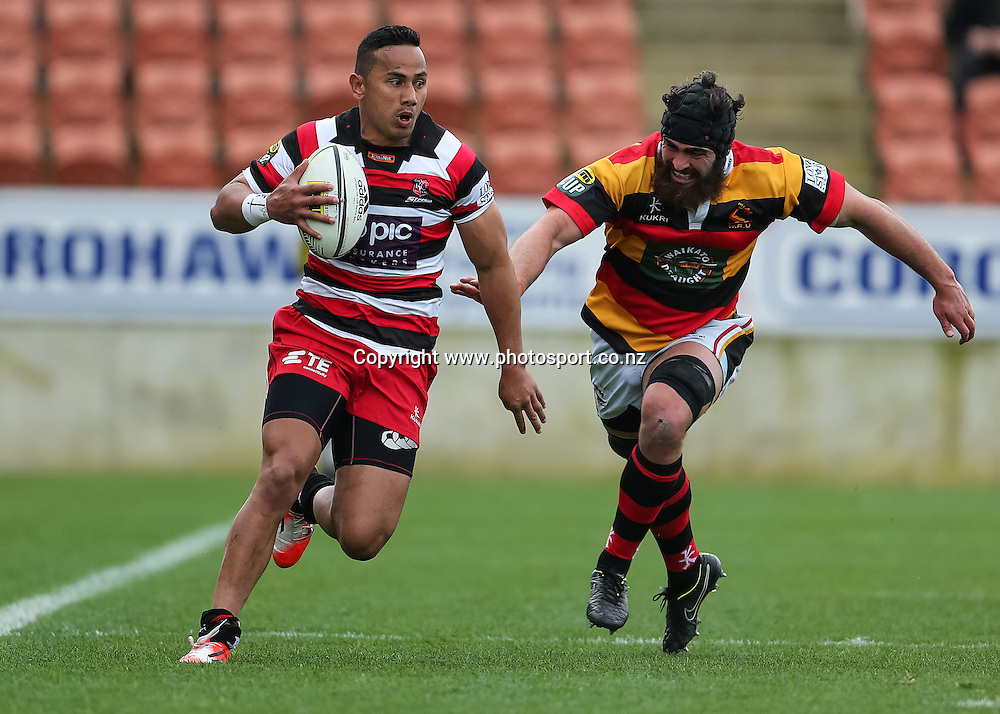 Counties Maunkau's Toni Pulu looks to beat Waikato's Adam Burn during the ITM Cup rugby match - Waikato v Counties Manukau at Waikato Stadium, Hamilton on Sunday 14 September 2014.  Photo: Bruce Lim / www.photosport.co.nz