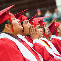 121213       Brian Leddy<br /> Navajo Technical University student Kevin Frazier calls out to the crowd during graduation ceremonies in Chinle Friday.