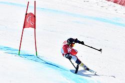 MISAWA Hiraku LW2 JPN competing in ParaSkiAlpin, Para Alpine Skiing, Super G at PyeongChang2018 Winter Paralympic Games, South Korea.