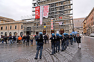 People demonstrate to protest against evictions, next to banners reading 'We are not terrorists, we are precarious occupants like many other', 'stop to evictions', put on the facade of the Palazzo Colonna at Piazza Santi Apostoli in front of the Prefecture in Rome.