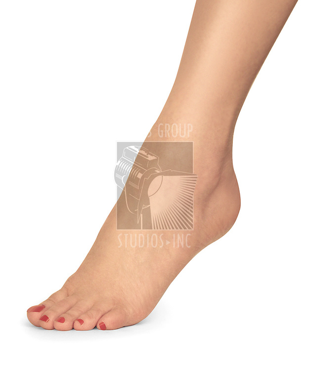 female foot with red nail polish on white background