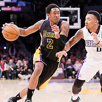 28 February 2014: Los Angeles Lakers shooting guard MarShon Brooks (2) drives past Sacramento Kings shooting guard Orlando Johnson during the Los Angeles Lakers 126-122 victory over the Sacramento Kings at the Staples Center, Los Angeles, California, USA.