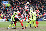 Lincoln City defender Scott Wharton (6) heads the ball towards goal during the EFL Sky Bet League 2 match between Lincoln City and Exeter City at Sincil Bank, Lincoln, United Kingdom on 30 March 2018. Picture by Mick Atkins.