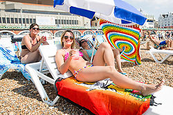 © Licensed to London News Pictures. 27/08/2017. Brighton, UK. JAQUELINE, TATI and MOLI from Brazil enjoy the sunshine on the beach in Brighton and Hove on the August the Bank holiday Sunday Photo credit: Hugo Michiels/LNP