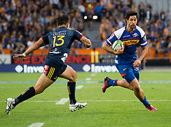 Stormers' EW Viljoen, right, looks to beat Highlanders' Rob Thompson in the Super Rugby match, Forsyth Barr Stadium, Dunedin, New Zealand, Friday, March 9, 2018. Credit:SNPA / Adam Binns ** NO ARCHIVING**