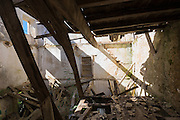 Wooden beams in derelict abandoned house ruin in ancient mountain village of Old Perithia - Palea Peritheia, Corfu, Greece