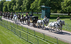 © Licensed to London News Pictures. 17/05/2018. Windsor, UK. A covered coach and horses process along the Long Walk towards Windsor Castle during a rehearsal of the wedding day  procession of Prince Harry and Meghan Markle. Photo credit: Peter Macdiarmid/LNP
