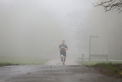 © Licensed to London News Pictures. 24/11/2019. London, UK. A jogger jogs in thick fog in Alexander Palace park,  north London on a freezing morning. Photo credit: Dinendra Haria/LNP