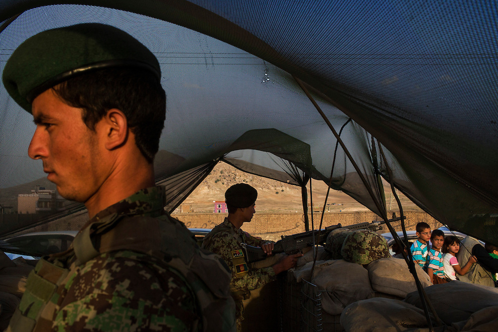 Two Afghan National Army soldiers secure a check point at the northern entrance of Kabul, on the road coming from Mazar-e-Sharif, in Afghanistan, on September 21, 2012. Photo by Mauricio Lima for The New York Times