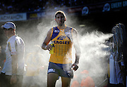 Daniel Wilkins, The Sunday Times - Eagle's ruckman Dean Cox walks through the water fans on the sidelines trying to cool down, during a pre season match