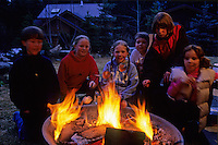Group of kids enjoy a campfire