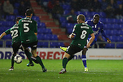 Freddie Ladapo of Oldham Athletic scores the opening goal of the game to make the score 1-0 during the EFL Sky Bet League 1 match between Oldham Athletic and Scunthorpe United at Boundary Park, Oldham, England on 18 October 2016. Photo by Simon Brady.