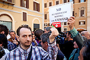 2013/04/18 Roma, proteste in piazza Montecitorio contro la mancata candidatura di Stefano Rodota' a presidente della Repubblica. Nella foto un iscritto del PD.<br /> Rome, protests and demo in Piazza Montecitorio against the non-candidacy of Stefano Rodota ' for president . In the picture a PD militant hold is card; the note reading ' no deadly embrace with the alligator (Caimano, nickname of Silvio Berlusconi) ' ' - &copy; PIERPAOLO SCAVUZZO