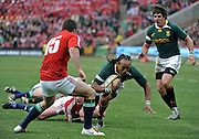 Odwa Ndungane of the Springboks tackled by Matthew Rees of the Lions with Jaque Fourie on the right.<br /> Rugby - 090704 - Springboks vs British&Irish Lions - Coca-Cola Park - Johannesburg - South Africa. The Lions won 28-9 but lost the series 2-1 to the Springboks.<br /> Photographer : Anton de Villiers / SASPA
