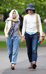 Peaches Geldof and fiancé Thomas Cohen spotted in a park close to their home, while their baby boy Astala was spending time with grandparents. Peaches and Thomas wearing a similar cream jumper and baggy jeans stopped off for lunch, before taking their beloved dog Parpy for a stroll around the park. Within minutes a down pour of rain came and Peaches removed her jumper and tied it around her head to keep dry.  The pair then returned home.... UK. 14/07/2012<br />BYLINE MUST READ : GOTCHAIMAGES.COM<br /><br />Copyright by © Gotcha Images Ltd. All rights reserved.<br />Usage of this image is conditional upon the acceptance <br />of Gotcha Images Ltd, terms and conditions available at<br />www.gotchaimages.com