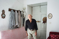 ACCIAROLI (POLLICA), ITALY - 5 OCTOBER 2016:  94-years-old Giuseppe Vassallo poses for a portrait in his house in Acciaroli, a hamlet in the municipality of Pollica, Italy, on October 5th 2016. Giuseppe Vassallo was an Italian Navy official during WWII. At age 86, 8 years ago, Mr Vassallo had multiple sex affairs to overcome his depression following his wife's death. He was a testimonial of the Acciaroli's mediterranean  diet and lifestyle during Expo 2015, the Universal Exposition hostel in Milan last year.<br /> <br /> To understand how people can live longer throughout the world, researchers at University of California, San Diego School of Medicine have teamed up with colleagues at University of Rome La Sapienza to study a group of 300 citizens, all over 100 years old, living in Acciaroli (Pollica), a remote Italian village nestled between the ocean and mountains in Cilento, southern Italy.<br /> <br /> About 1-in-60 of the area's inhabitants are older than 90, according to the researchers. Such a concentration rivals that of other so-called blue zones, like Sardinia and Okinawa, which have unusually large percentages of very old people. In the 2010 census, about 1-in-163 Americans were 90 or older.