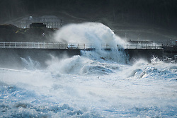 © London News Pictures. 22/10/2017. Aberystwyth,UK. Waves continue to crash on to the shore as the tail end of storm Brian is still battering the seafront and promenade in Aberystwyth on the Cardigan Bay coast of west wales. Photo credit: Keith Morris/LNP