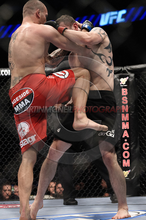 "LONDON, ENGLAND, JUNE 7, 2008: Jess Liaudin (left) connects with a knee to the stomach of Paul Taylor during ""UFC 85: Bedlam"" inside the O2 Arena in Greenwich, London on June 7, 2008."