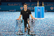 Andy Murray of Great Britain  with both his ATP Finals and ATP Number One trophies after the Finals and day eight of the Barclays ATP World Tour Finals at the O2 Arena, London, United Kingdom on 20 November 2016. Photo by Martin Cole.