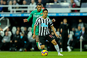 Yoshinori Muto (#13) of Newcastle United on the ball pursued by Etienne Capoue (#29) of Watford during the Premier League match between Newcastle United and Watford at St. James's Park, Newcastle, England on 3 November 2018.