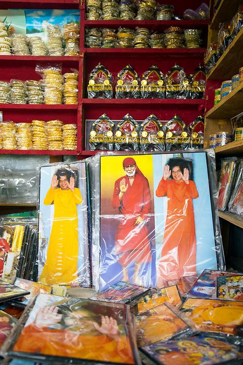 PUTTARPATHI, INDIA - 01st November 2019 - Photo postcard prints the late Sai Baba of Shirdi and Sathya Sai Baba for sale at a market stall in Puttarpathi, Andhra Pradesh, South India