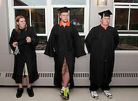 "Robert Kelley, Zachary LeRoy and Calvin ""CJ"" Follansbee await commencement exercises at Prospect Mountain High School Friday evening.  (Karen Bobotas/for the Concord Monitor)"