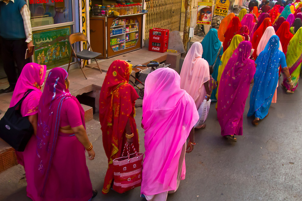 Women in saris walking in a wedding procession, Udaipur, Rajasthan, India