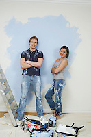 Couple resting while painting wall portrait