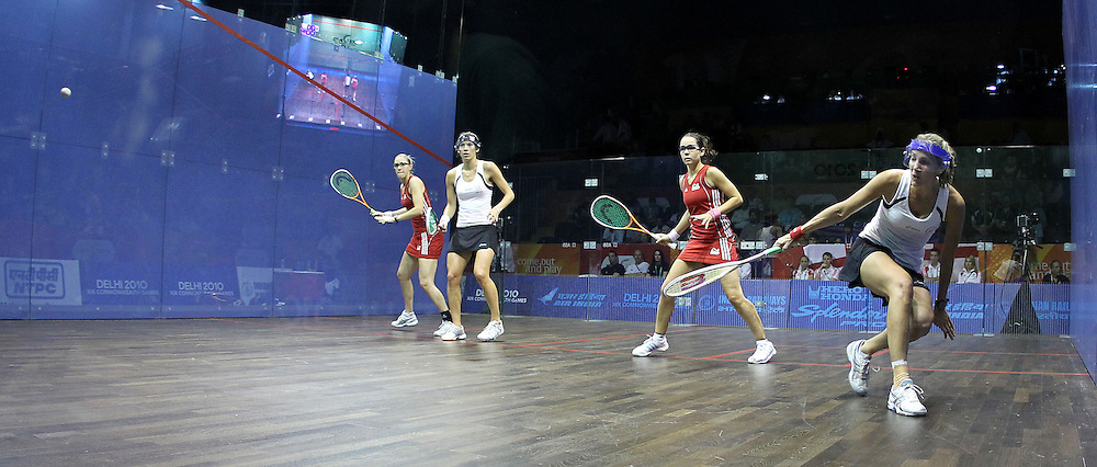 Joelle King and Jaclyn Hawkes of New Zealand take on Jenny Duncalf and Laura Massaro of England during the final of the women's doubles squash competition held at the Siri Fort Complex in New Delhi as part of the XIX Commonwealth Games, India on the 13 October 2010..Photo by:  Ron Gaunt/photosport.co.nz