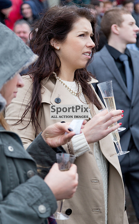 146th New Year Sprint 1 January 2015; two glasses of bubbly at a time for this punter at Musselburgh Racecourse, Musselburgh;