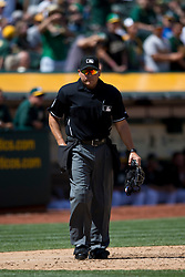 OAKLAND, CA - APRIL 11:  MLB umpire Mark Carlson #6 stands behind home plate during the fifth inning between the Oakland Athletics and the Seattle Mariners at O.co Coliseum on April 11, 2015 in Oakland, California. The Seattle Mariners defeated the Oakland Athletics 5-4 in 11 innings. (Photo by Jason O. Watson/Getty Images) *** Local Caption *** Mark Carlson