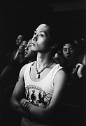 Japanese teens homage to punk, standing with is arms folded, wearing a padlock chain and vest, Japan, 2003