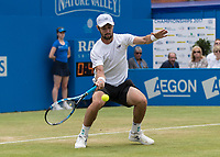 Tennis - 2017 Aegon Championships [Queen's Club Championship] - Day Four, Thursday <br /> <br /> Men's Singles: Round of 16 - Jordan THOMPSON (AUS) vs Sam QUERREY (USA)<br /> <br /> Jordan Thompson (AUS) gets down low to return at Queens Club<br /> <br /> COLORSPORT/DANIEL BEARHAM