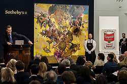 "© Licensed to London News Pictures. 10/02/2016. London, UK.  (L to R) Adrian Ghenie's ""The Sunflowers"" and Andy Warhol's ""Large Campbell's Soup Can"", which sold for a hammer price of £14.2m and £4.45m respectively, at Sotheby's Contemporary Art evening sale in New Bond Street.   Photo credit : Stephen Chung/LNP"
