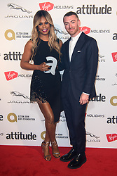 Laverne Cox with Sam Smith after she won the Inspiration Award, at the Attitude Awards at the Roundhouse, London.
