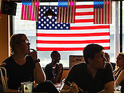 09 NOVEMBER 2016 - BANGKOK, THAILAND:  Members of Democrats Abroad Thailand watch election results come in Wednesday morning (Thai time). Democrats Abroad Thailand met at the Roadhouse Barbecue, an American restaurant in Bangkok to watch election results come in. It was a somber election watch party as what was expected to be a Clinton victory turned into a Trump win.     PHOTO BY JACK KURTZ