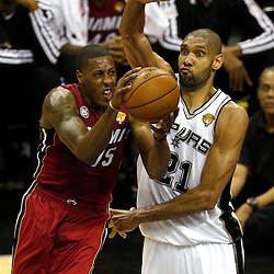 Jun 11, 2013; San Antonio, TX, USA; Miami Heat point guard Mario Chalmers (15) drives to the basket defended by San Antonio Spurs power forward Tim Duncan (21) in the first quarter during game three of the 2013 NBA Finals at the AT&T Center. Mandatory Credit: Derick E. Hingle-USA TODAY Sports