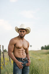 sexy shirtless cowboy outdoors on a ranch