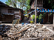 20 MARCH 2017 - BANGKOK, THAILAND: An empty lot that used to be a home in Pom Mahakan. As families are evicted the government immediately tears down the home so squatters don't move into it. The final evictions of the remaining families in Pom Mahakan, a slum community in a 19th century fort in Bangkok, have started. City officials are moving the residents out of the fort. NGOs and historic preservation organizations protested the city's action but city officials did not relent and started evicting the remaining families in early March.               PHOTO BY JACK KURTZ