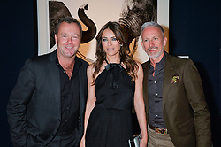 Left to right, DAVID YARROW, ELIZABETH HURLEY and PATRICK COX at the Christie's Conservation Lectures in aid of Tusk held atChristie's, 8 King Street, London on 30th April 2014.