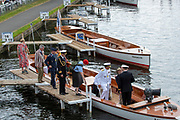 Henley on Thames, England, United Kingdom, Sunday, 07.07.19, Representatives of the Military crews, taking part in the King's Cup, together with Lieutenant Commander Pete REED, (centre Right), embarking the Umpire's Launch,  Henley Royal Regatta,  Henley Reach, [©Karon PHILLIPS/Intersport Images]<br /> <br /> 14:40:03 1919 - 2019, Royal Henley Peace Regatta Centenary,