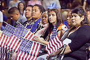 """04 JULY 2009 -- PHOENIX, AZ:  Candidates for citizenship wait to be sworn in as US citizens at a naturalization ceremony in Phoenix, AZ, July 4. U.S. Citizenship and Immigration Services and South Mountain Community College in Phoenix, AZ, hosted the 21st annual """"Fiesta of Independence"""" Saturday, July 4. More than 180 people from 58 countries took the US Oath of Citizenship and became naturalized US citizens. The ceremony was one of dozens of similar ceremonies held across the US this week. USCIS said more than 6,000 people were naturalized US citizens during the week.  Photo by Jack Kurtz / ZUMA Press"""